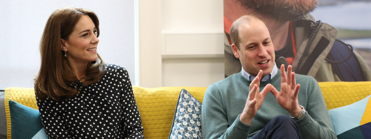 The Duke and Duchess of Cambridge sitting on a couch inside Jigsaw Dublin City