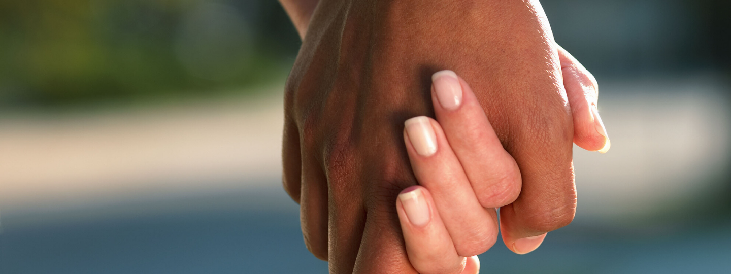 Two people holding hands, close up on the hands