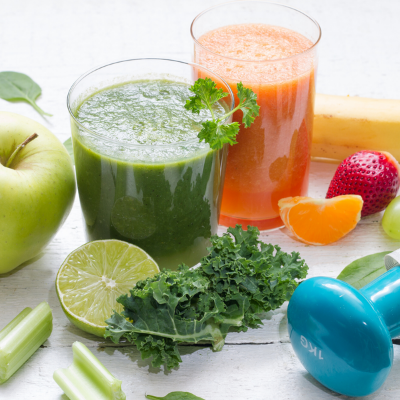 Picture of green smoothies, vegetables, and a exercise weight