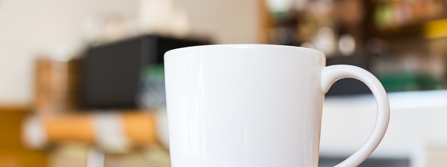 white mug with blurred background