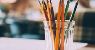 A image of pencils in a glass
