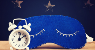 a image of a alarm clock and a eye mask