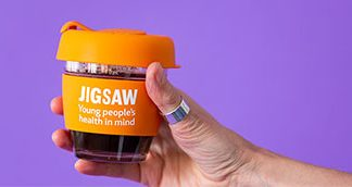 Hand holding Jigsaw branded keepy cup